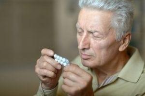 Man Treating his Barometric Pressure Headache