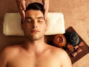 man-having-head-massage-in-the-spa-salon